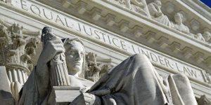 High court seems split in dispute over false Internet data